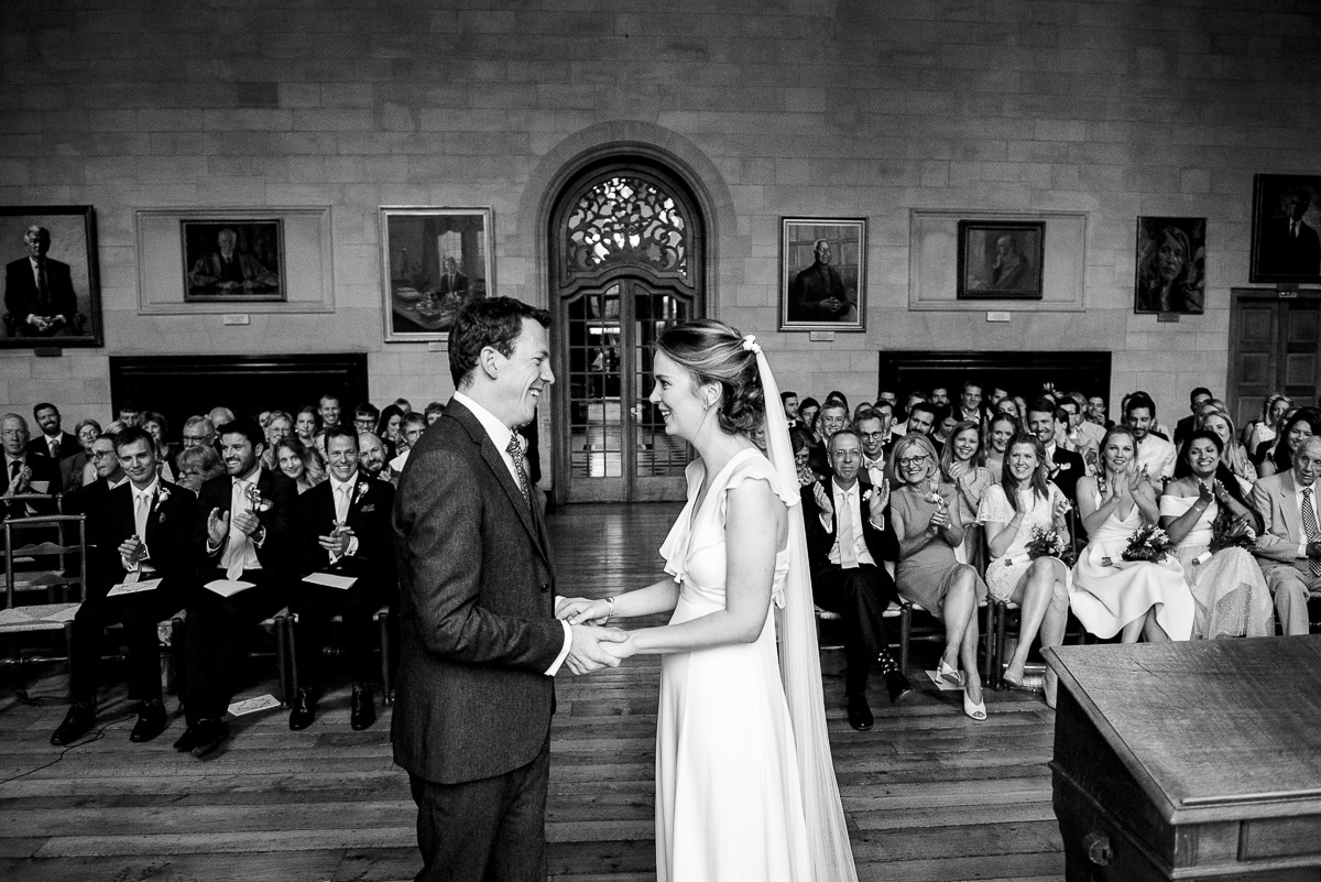 Bride and groom's first kiss wedding ceremony at Rhodes House photo