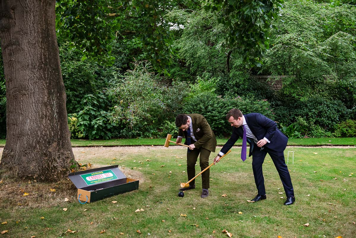 Two guests battle over the ball playing croquet on lawn at Rhodes House