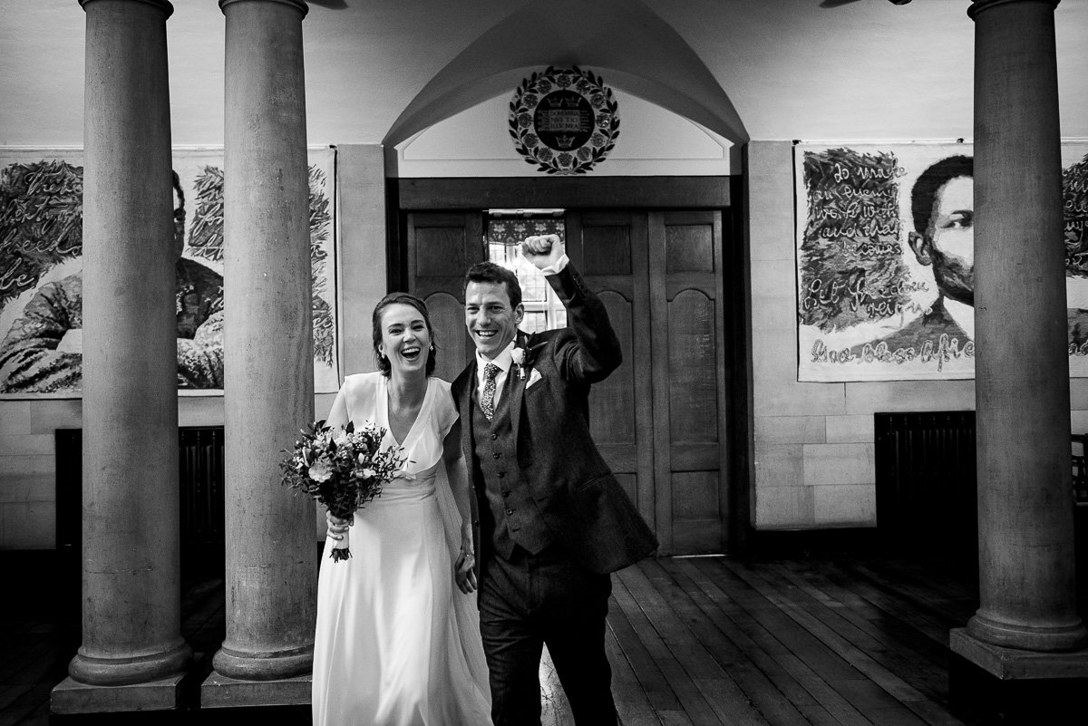 Bride and groom make their entrance to the wedding breakfast photo