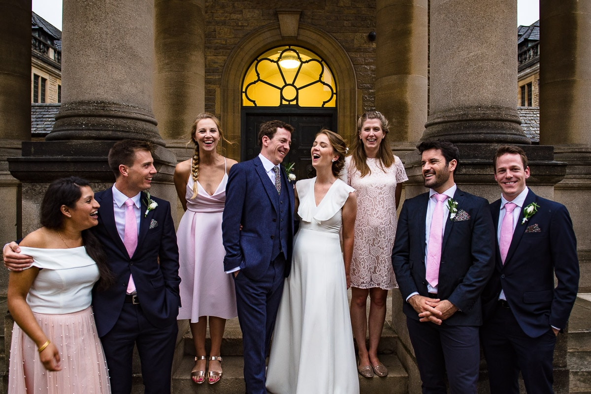 Bridal party group photo outside of Rhodes House Oxford in England