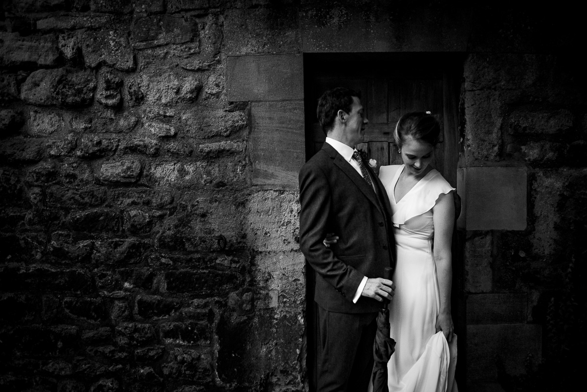 Dark and moody low light bride and groom portrait photo