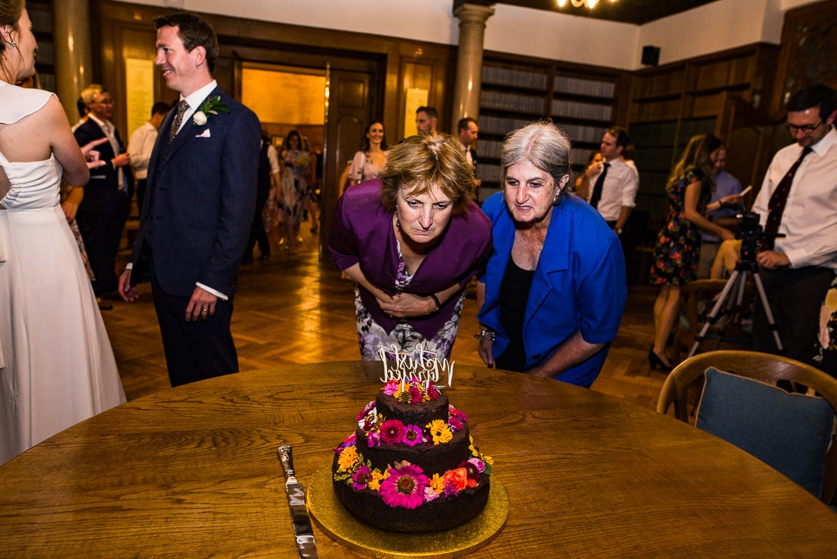 Wedding guests admire the cake at Rhodes House photo