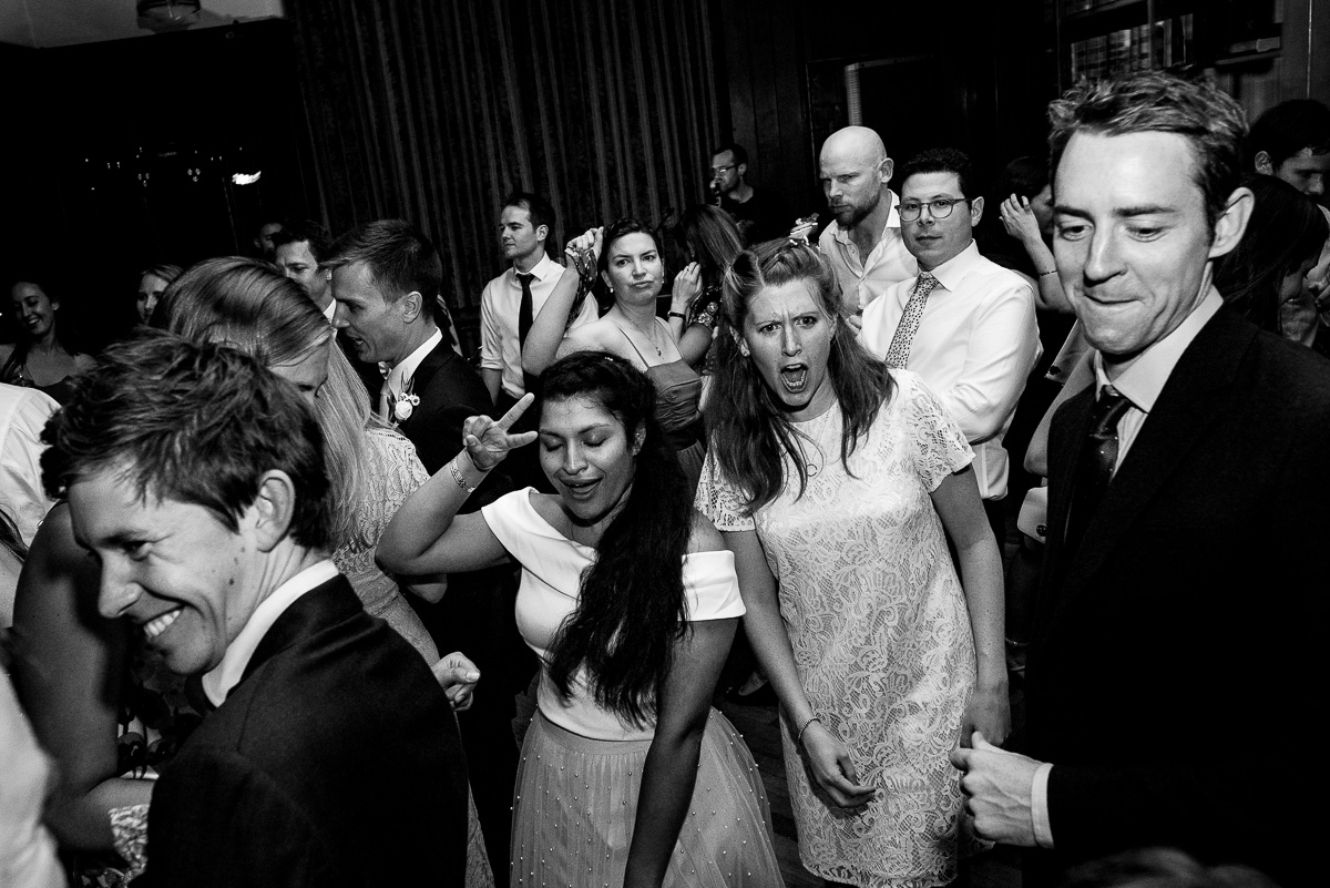 Party on the dance floor at Rhodes House documentary wedding photo