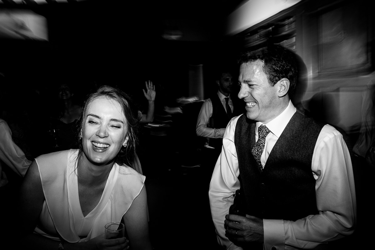 Bride and groom party on the dance floor at Rhodes House documentary wedding photo