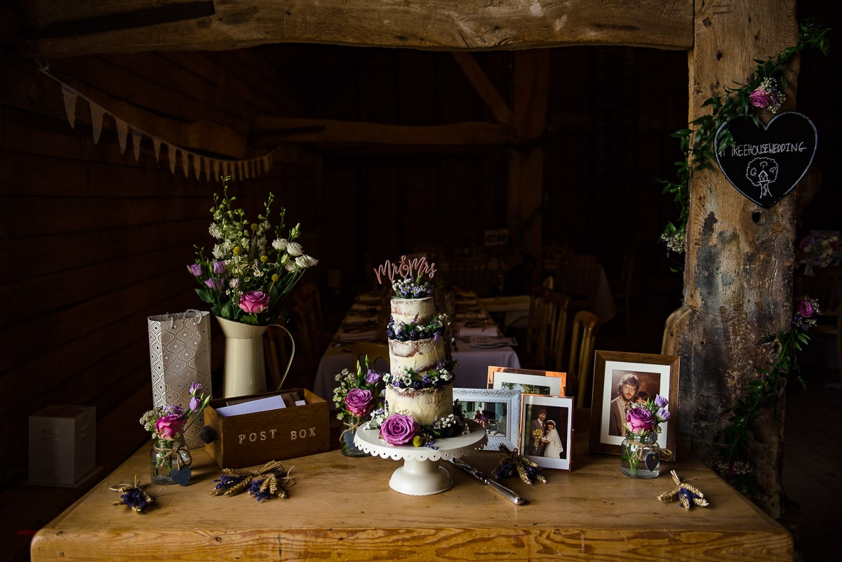 vintage wedding cake surrounded by decorations and photos detail
