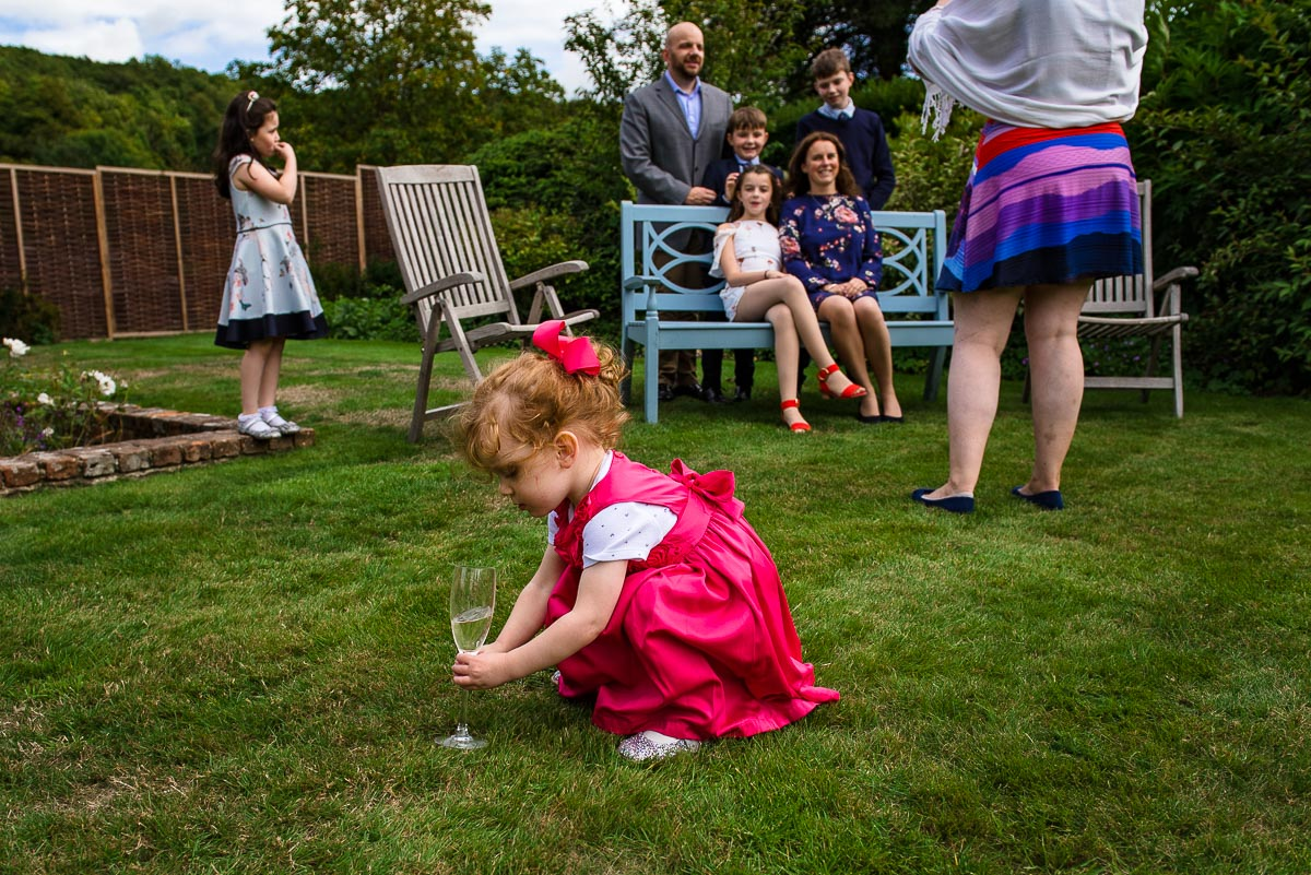 wedding guest child plants champagne glass of water into the garden