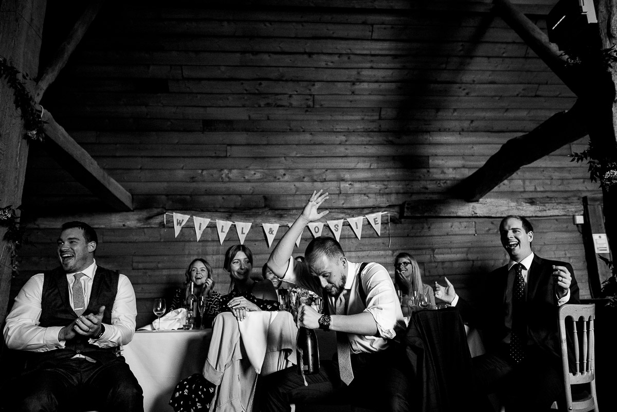 wedding guests in hysterics after funny wedding speech