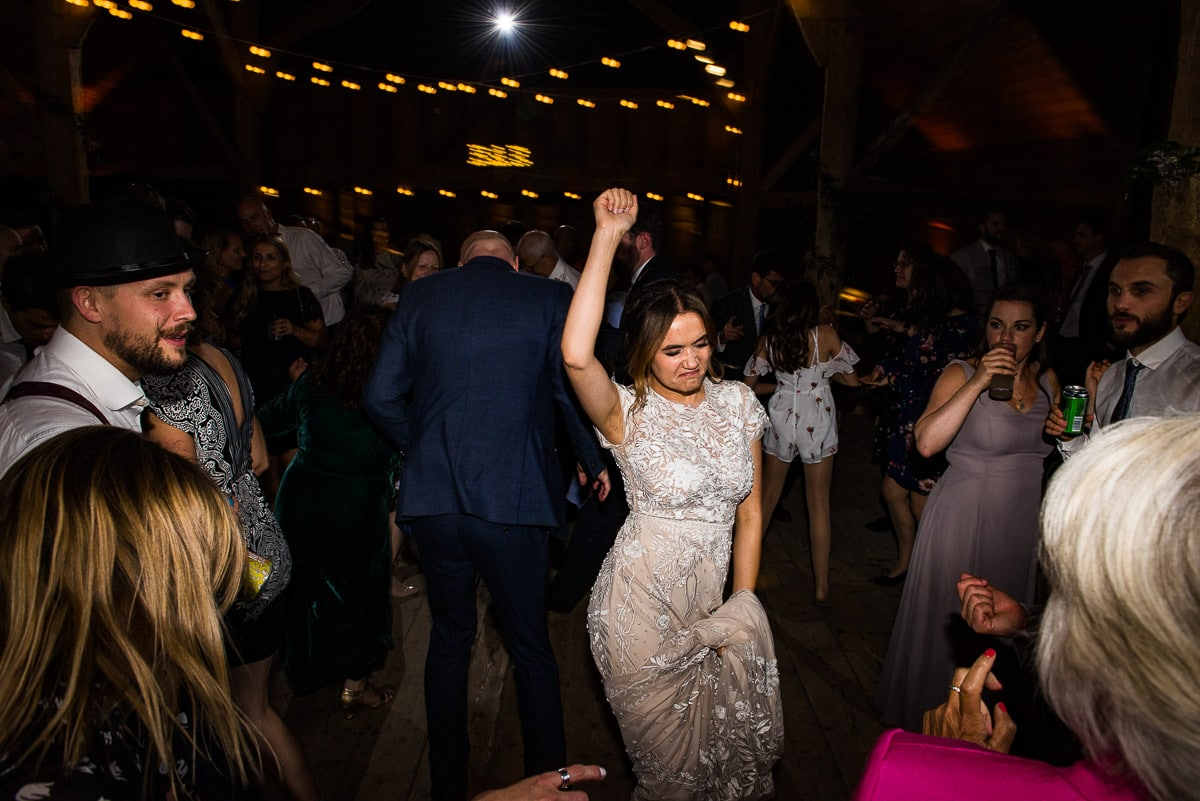 wedding guest boogies and dances to their favourite song on the dance floor