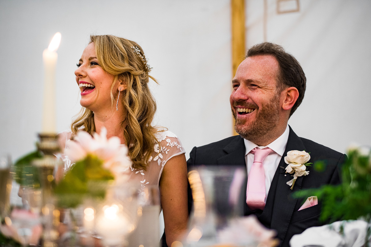 bride and groom laugh at speeches Cornwell manor