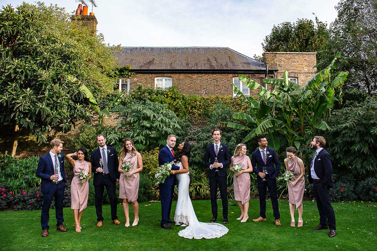groomsmen and bridesmaids group photo in Cambridge Cottage garden Kew gardens