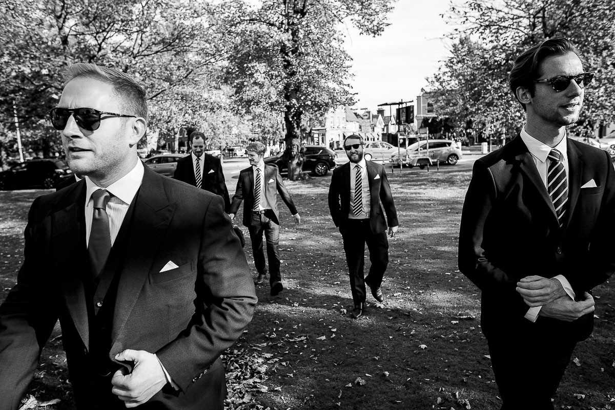 groomsmen arrive wearing sunglasses at cambridge Cottage wedding