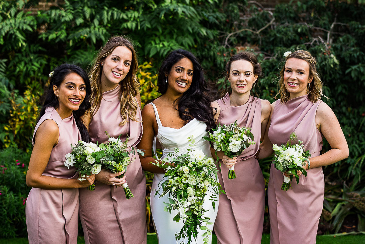 bride with bridesmaids with bouquets outside cambridge Cottage Kew gardens London