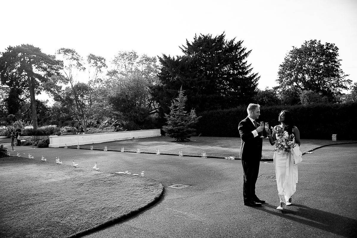 bride and groom share a drink and moment of solitude Kew Gardens Richmond