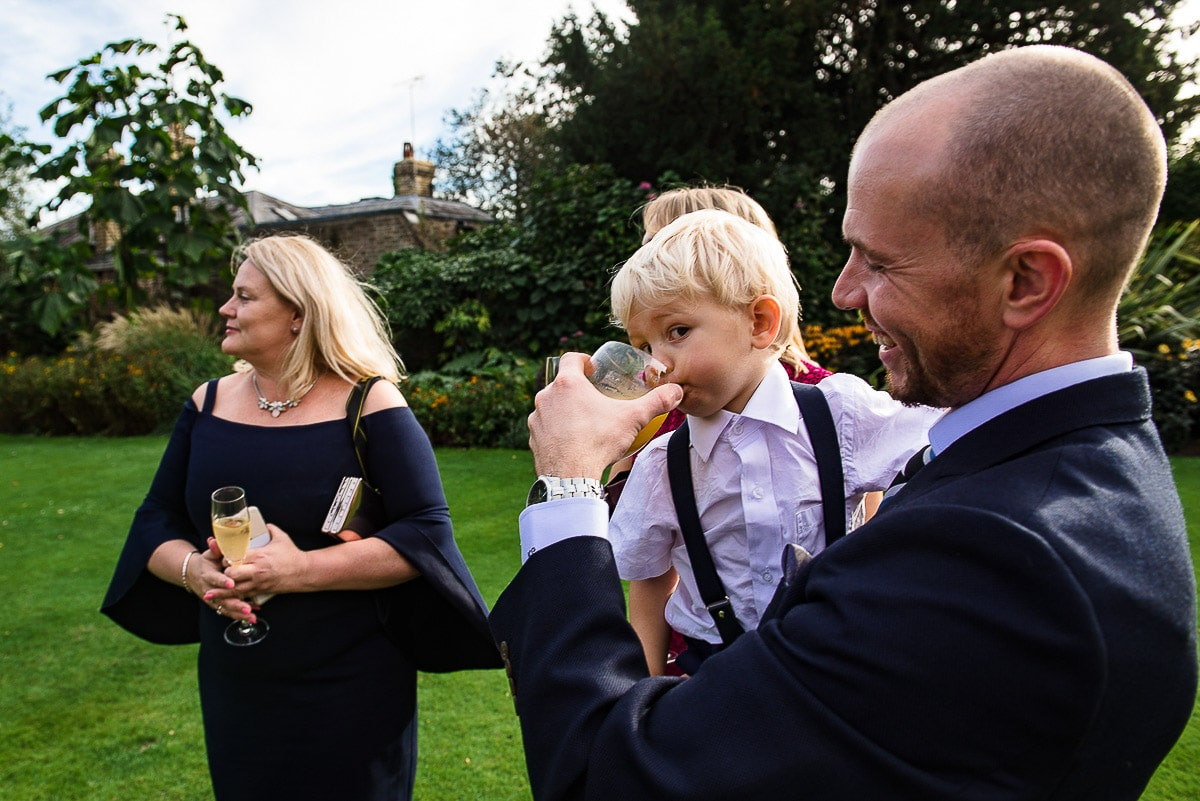 young wedding guest tries their parents drink