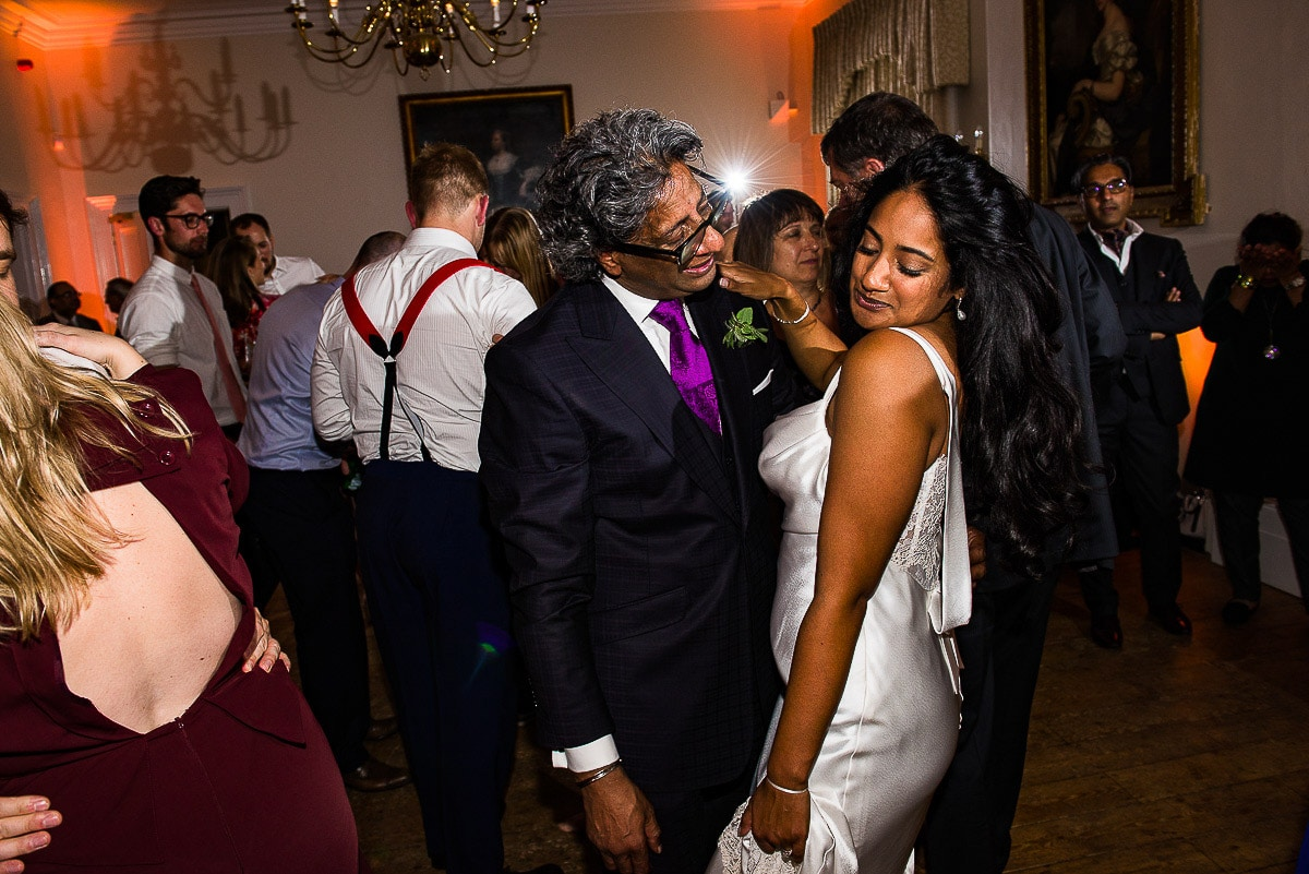 Bride dances with her father during wedding party dancefloor