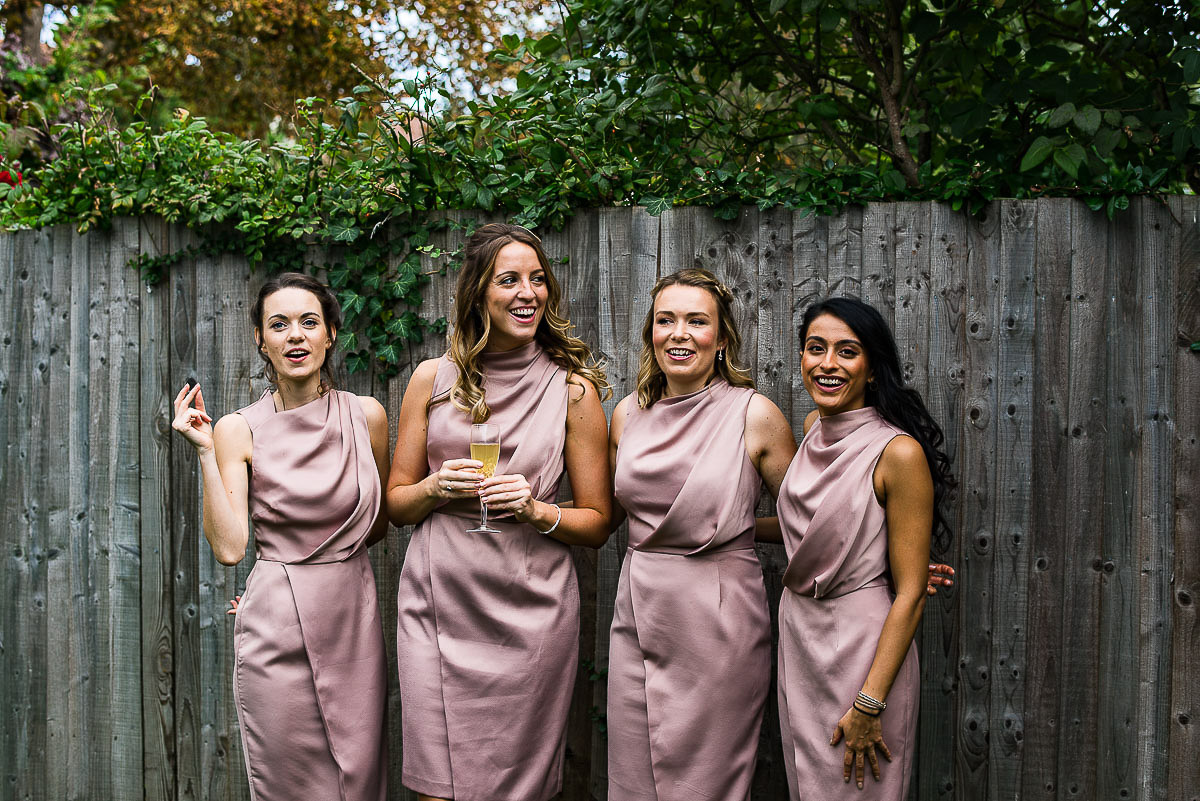 bridesmaids wearing pink dresses from Coast