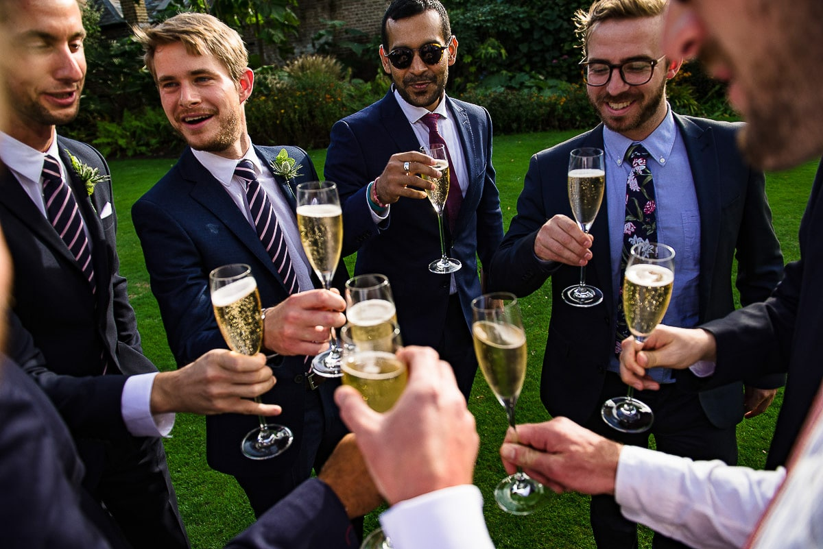 Men in suits with loads of Champagne