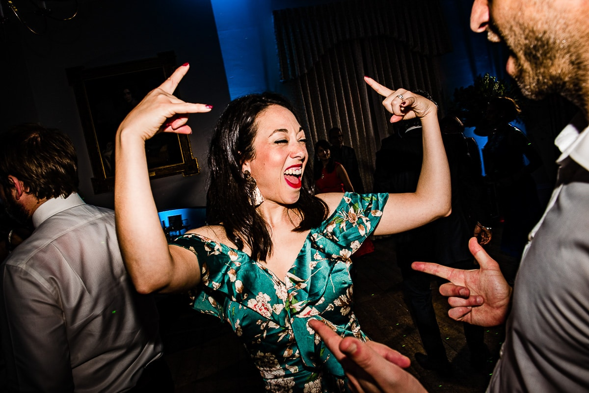 wedding guests rock out to dance floor music
