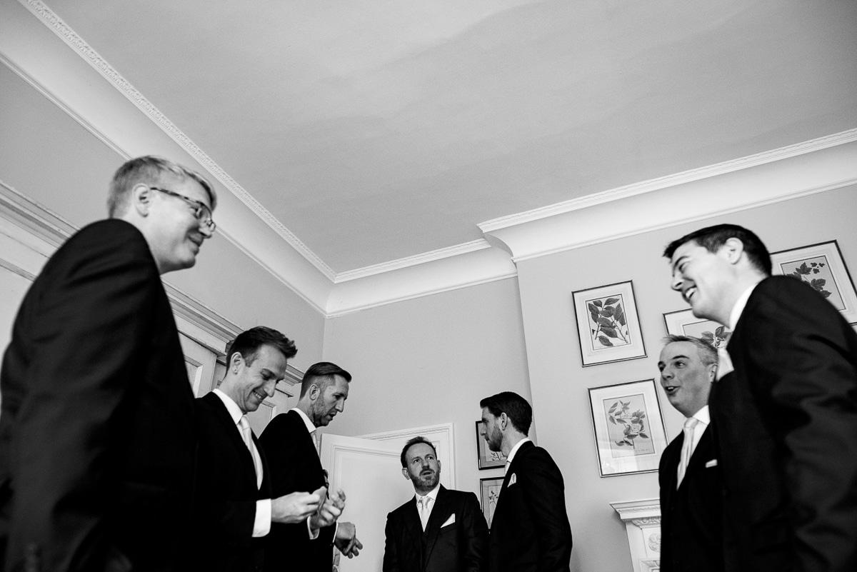 groomsmen and groom in Cornwell Manor bedroom