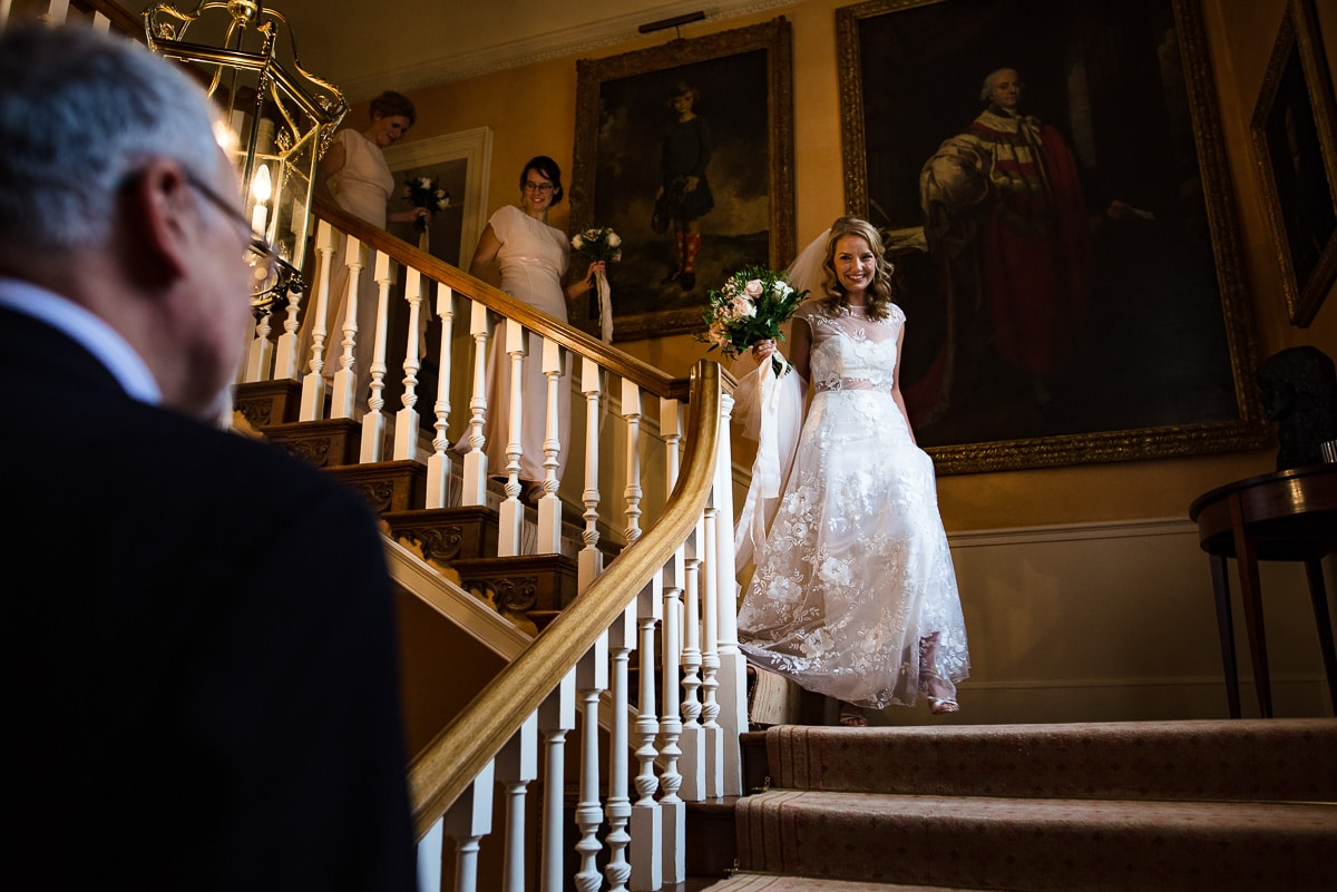 bride in Rime Arodaky wedding dress comes downstairs to awaiting father