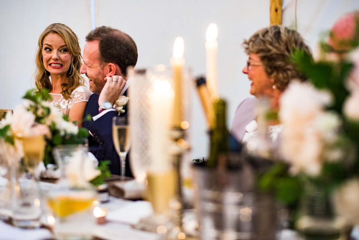 wedded couple cringe at embarrassing speech in marquee