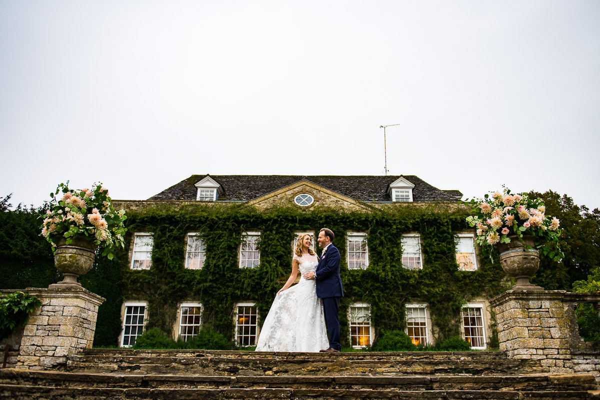 bride and groom outside Cornwell manor in the cotswolds