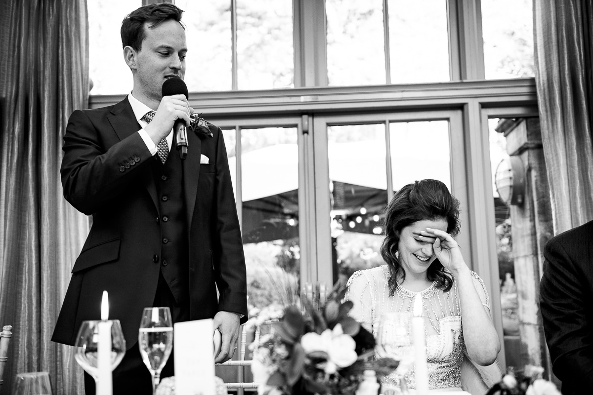 bride blushes at embarrassing speach from groom
