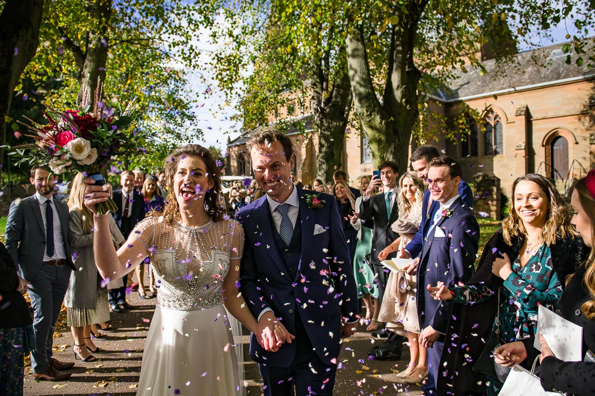wedding guests celebrate marrige with confetti