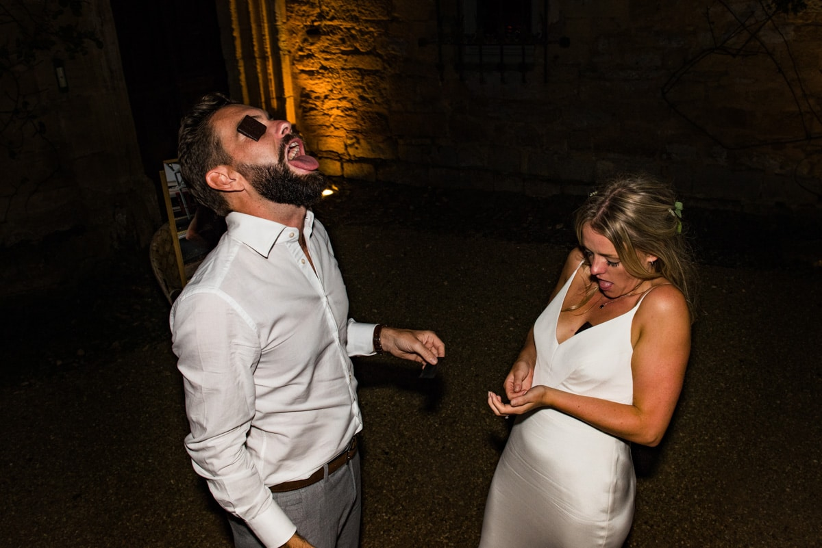 bride and groom play wedding game with mints