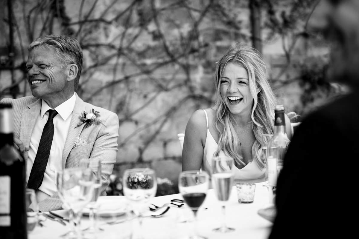 bride laughs at silly wedding speech