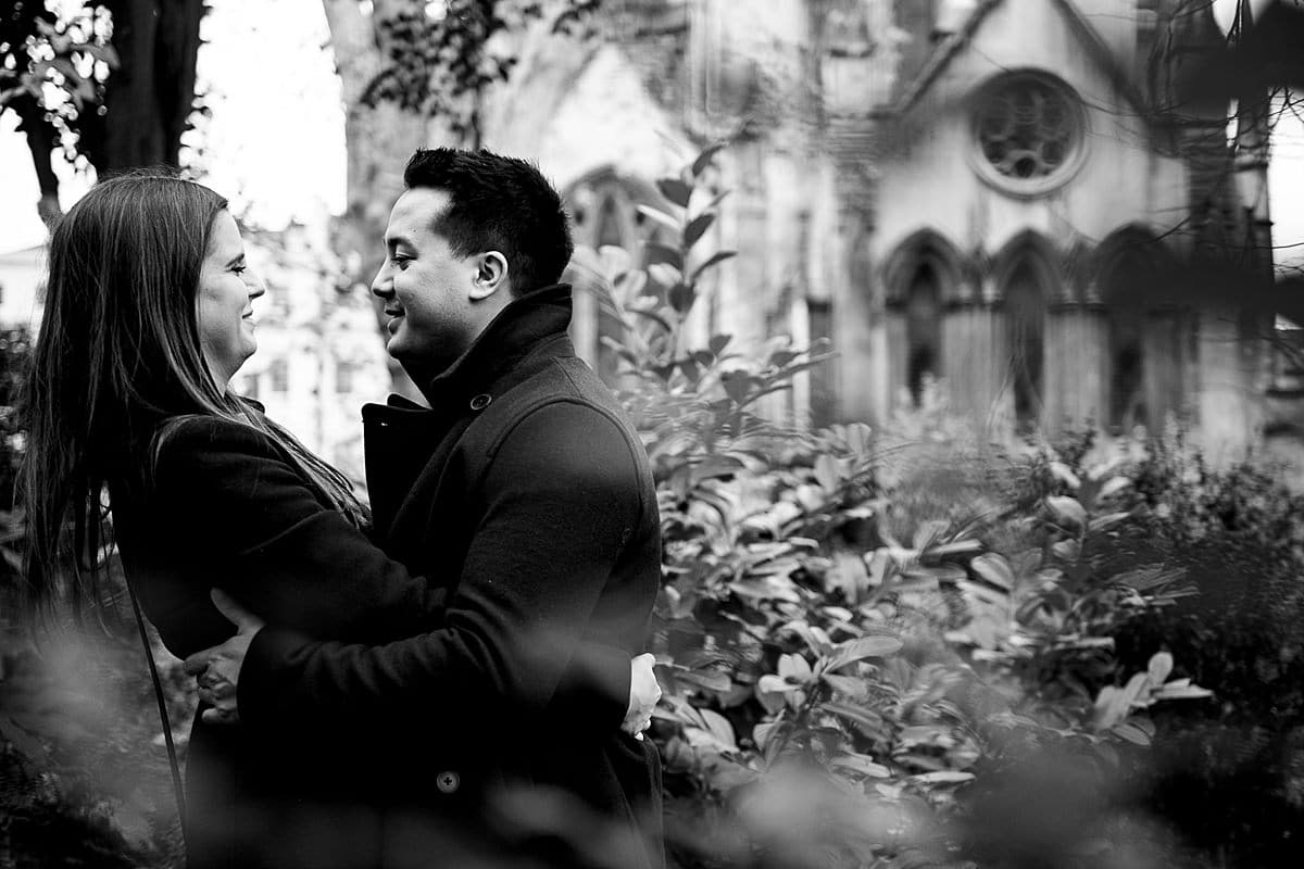 couple hug in blooming church garden