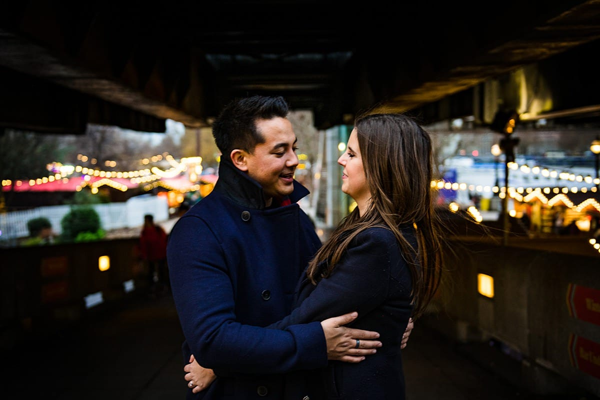 Photo shoot with couple in London market winter lights