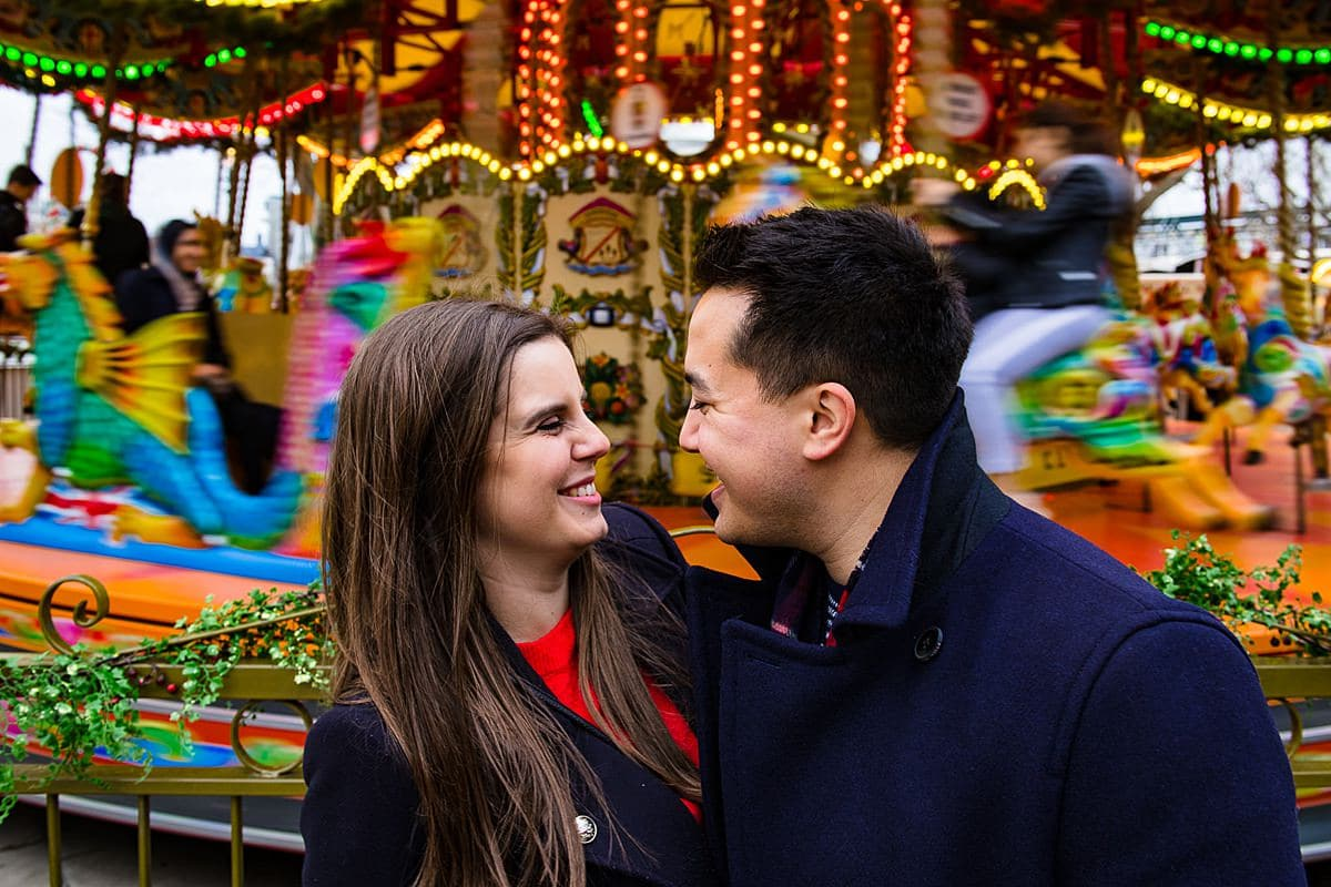 London merry-go-round colourful engagement photo