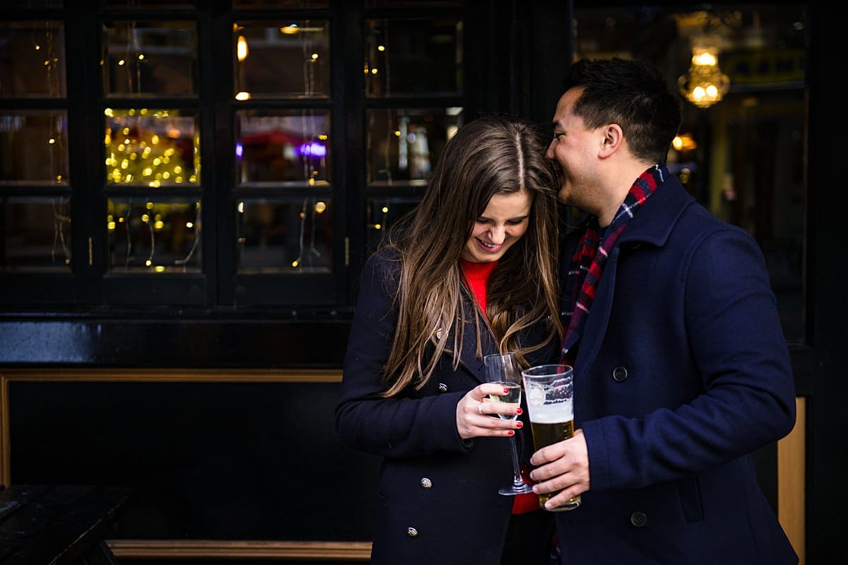 couple enjoy a drink outside popular london bar
