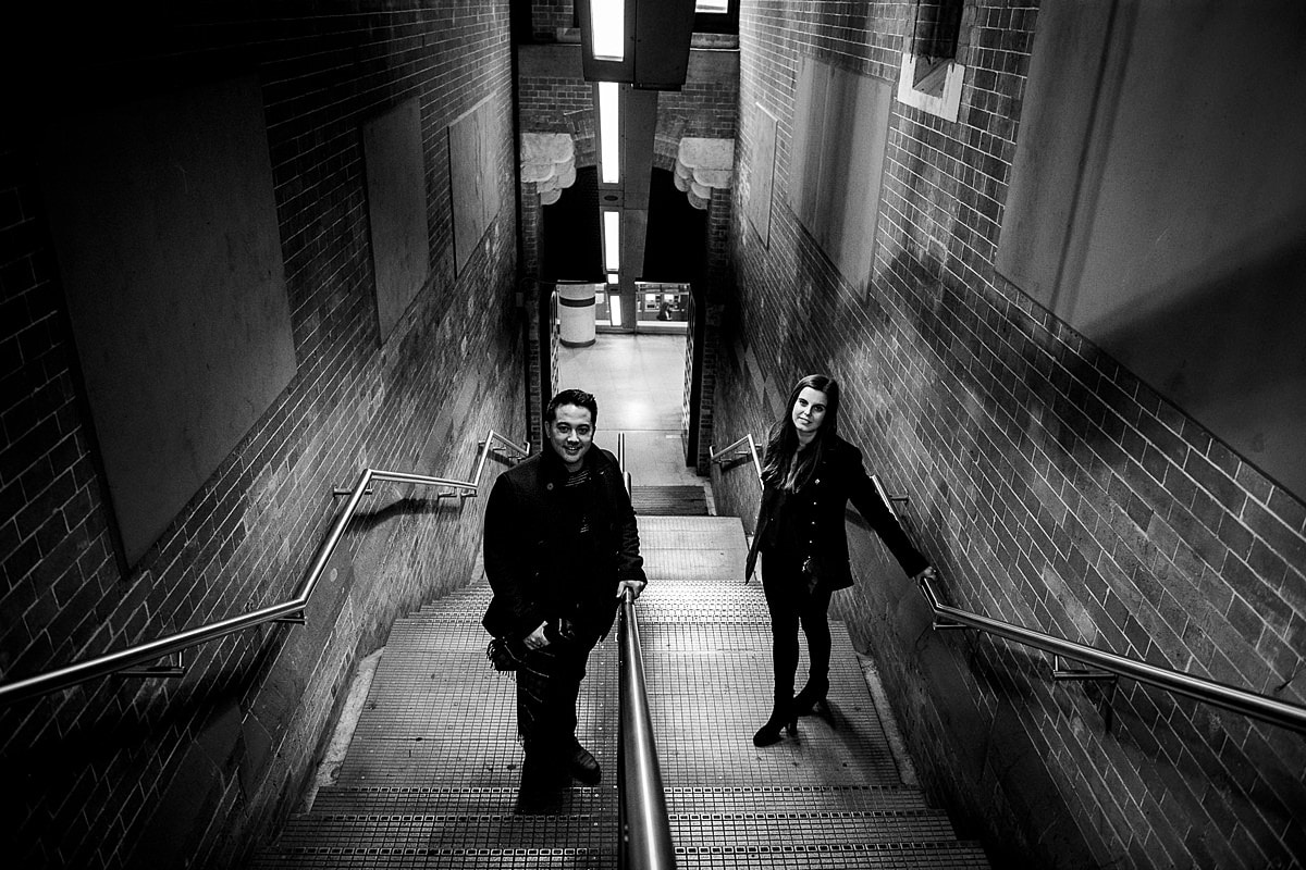 moody black and white portrait on the London underground stairs