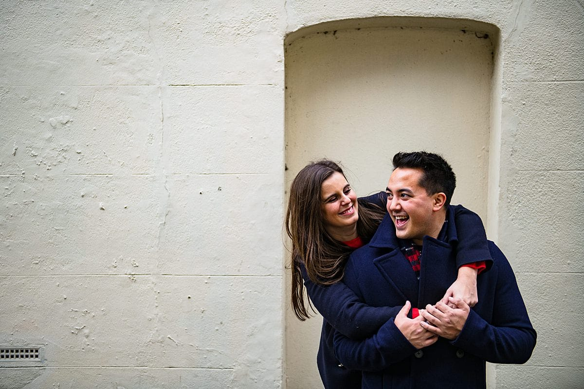 Playful couple on their London engagement photo shoot