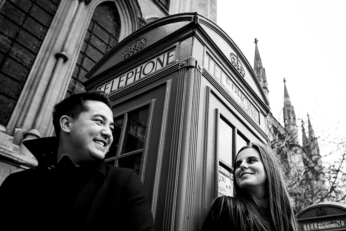 Engaged couple by telephone box in London