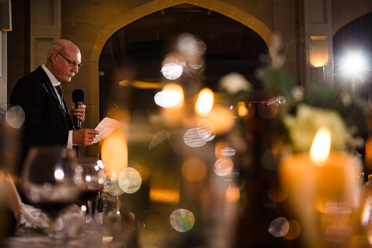 father of bride reads wedding speech twinkling fairy lights