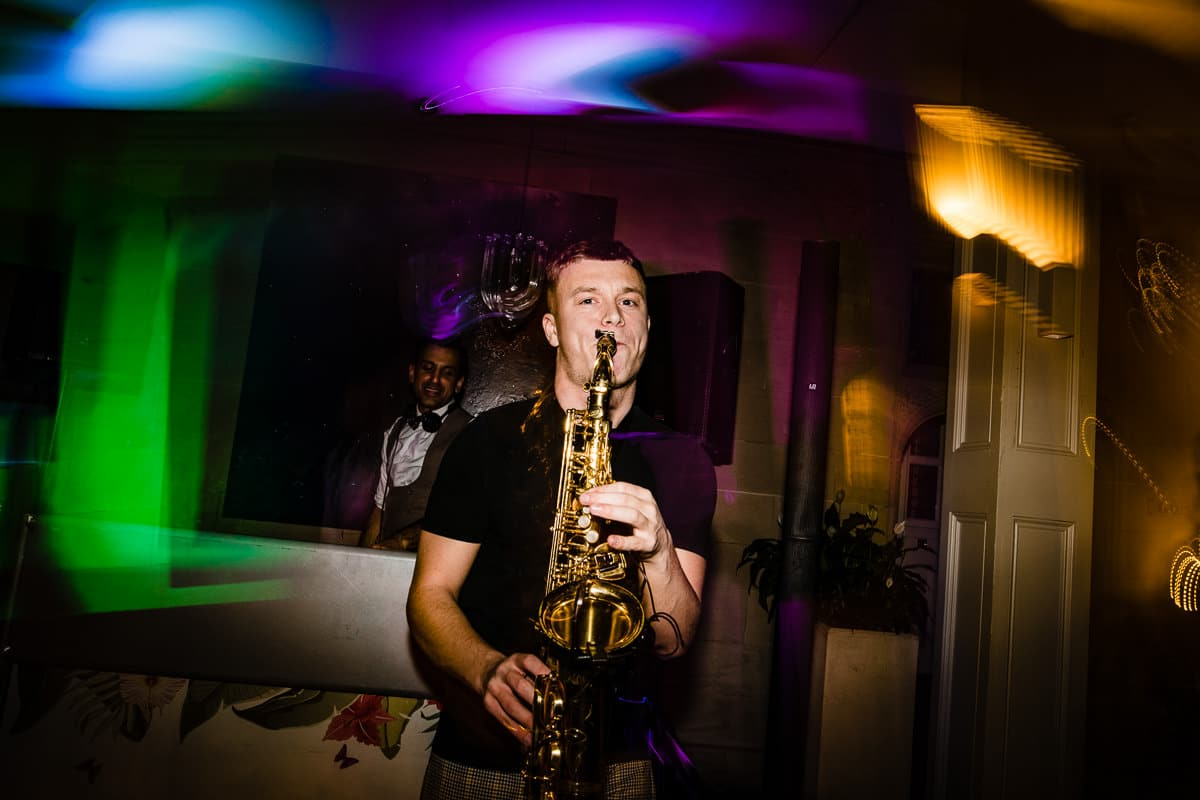 saxophonist entertains the wedding party on dance floor
