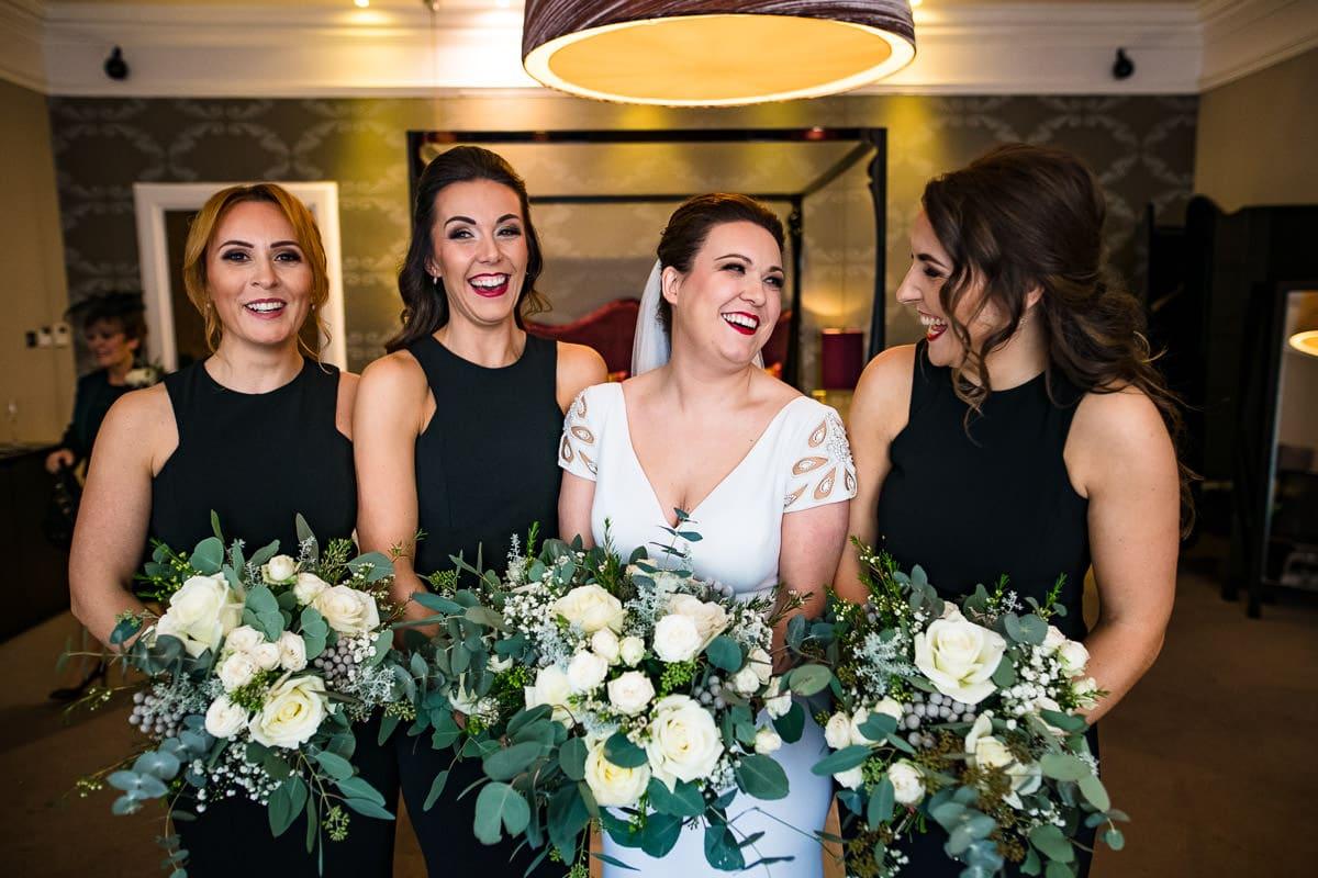 bride and bridesmaids in bridal suite Hampton Manor hotel