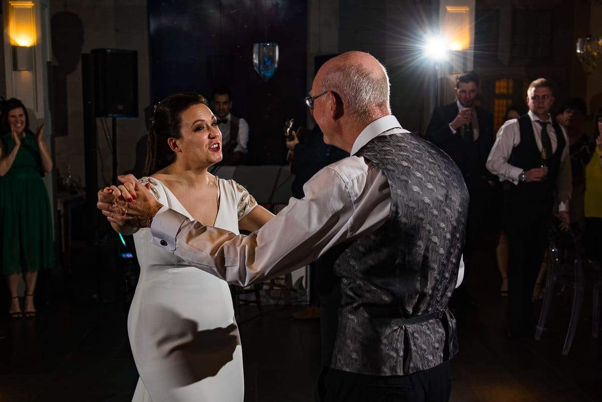 bride dances with her father on the dance floor Hampton Manor