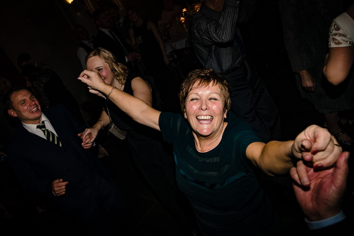 wedding guests sing and dance to favourite songs on dance floor