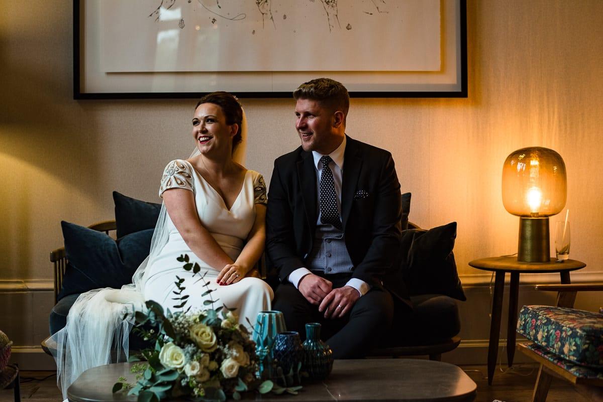 bride and groom sofa boutique wedding venue Hampton Manor