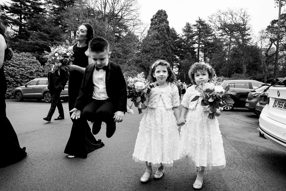 young wedding guests gather as they enter wedding