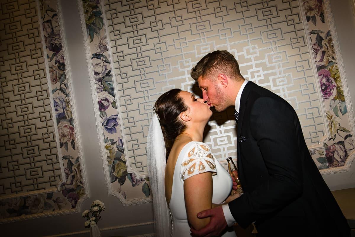 bride and groom kiss designer wallpaper