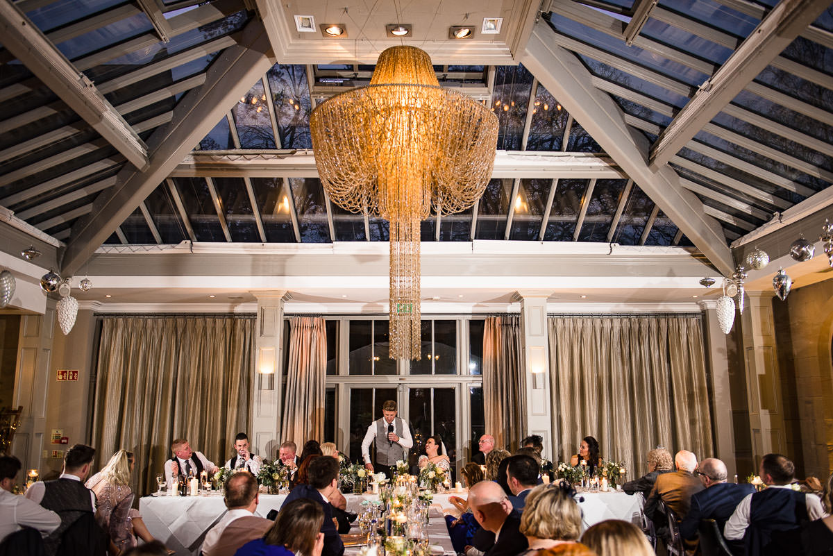 wedding speeches at banquet dining table chandelier