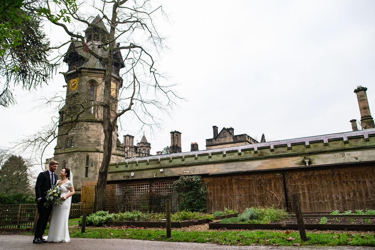 bride and groom outside Hampton manor wedding venue