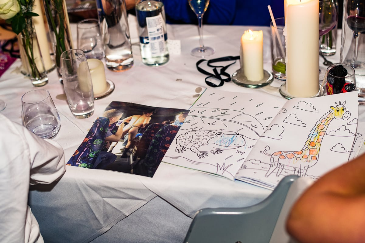 wedding dining table colouring book and photo candid detail