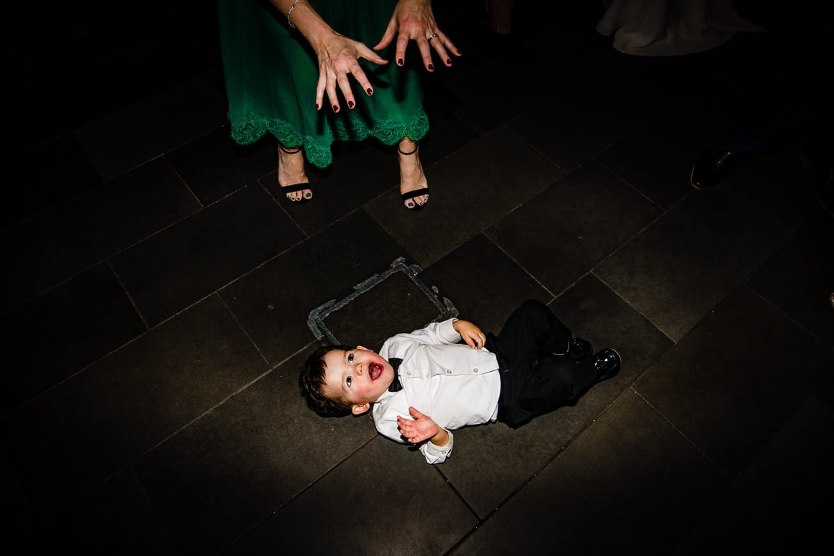 wedding guest entertains younger guest on dance floor