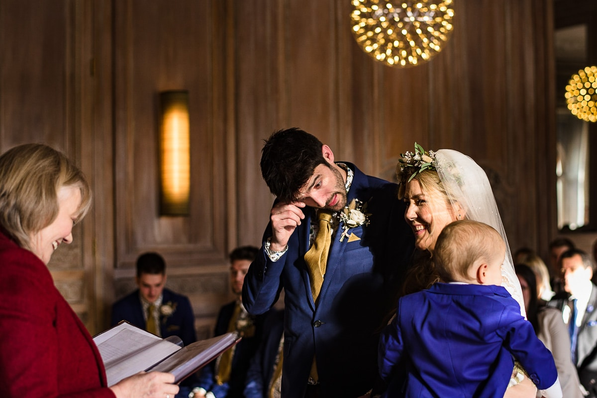 groom gets emotional Cowley manor winter wedding ceremony